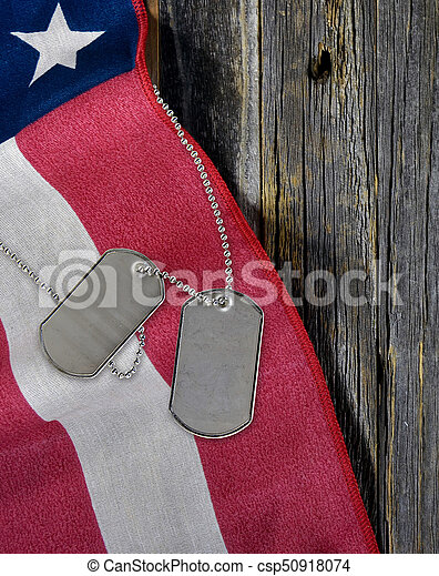 military dog tags on American flag - csp50918074