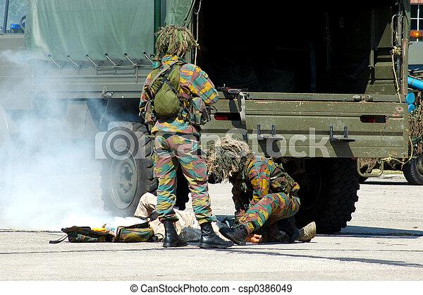 Military intervention, injured soldier. - csp0386049