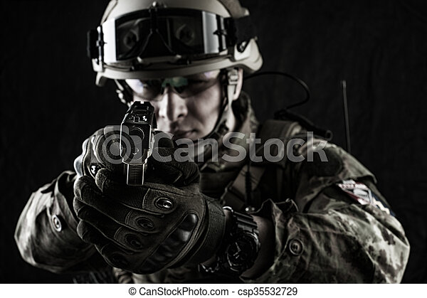 military man in italian camouflage aiming from handgun - csp35532729