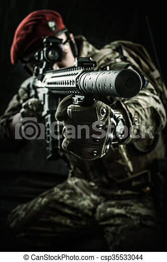 military man in italian camouflage aiming from automatic rifle - csp35533044