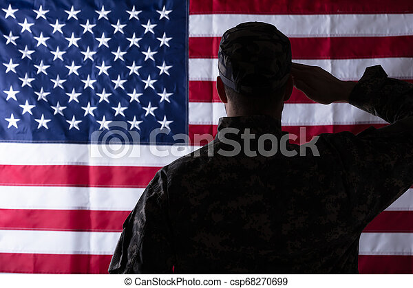 Military Man Saluting Us Flag - csp68270699