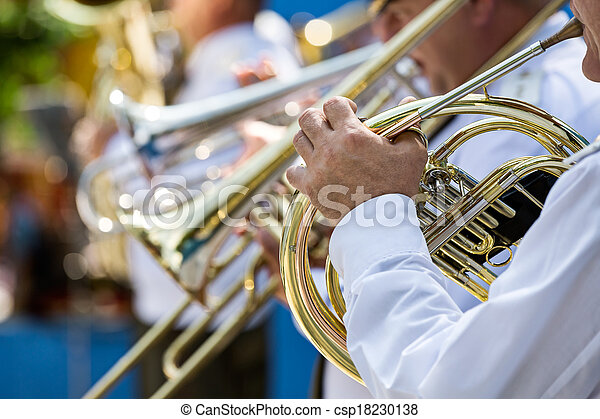 Military musician playing a horn - csp18230138