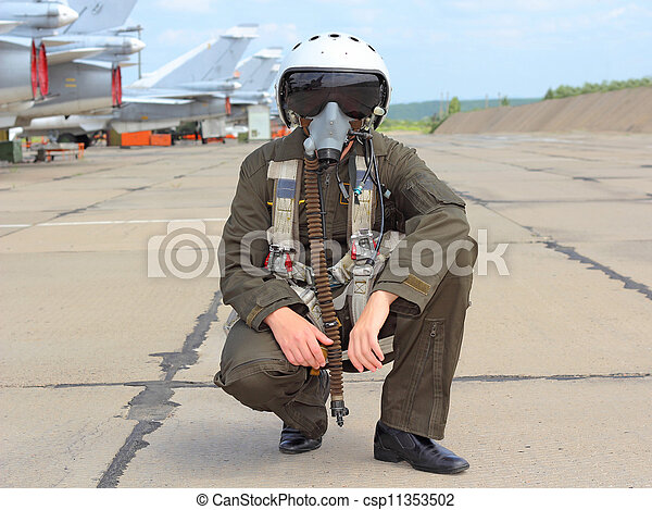 military pilot in a helmet near the aircraft - csp11353502