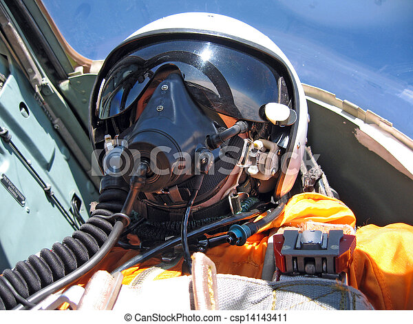 military pilot in the plane in a helmet in dark blue overalls against the blue sky - csp14143411