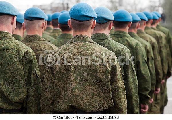 Military uniform soldier row - csp6382898
