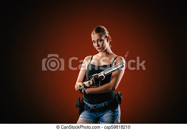 Military woman with a sport gun over black background - csp59818210
