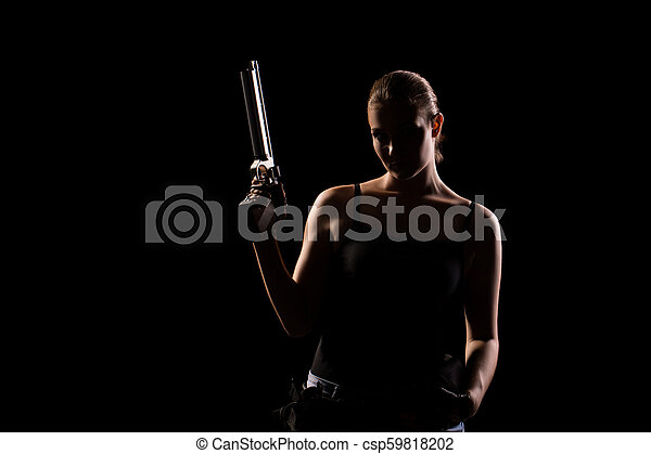 Military woman with a sport gun over black background - csp59818202