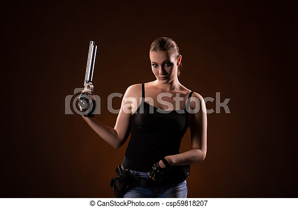 Military woman with a sport gun over black background - csp59818207