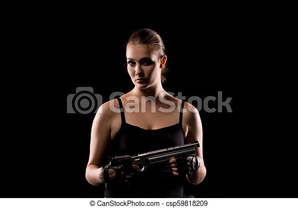 Military woman with a sport gun over black background - csp59818209