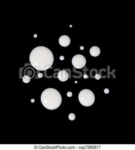 milk drops on black - csp7285817