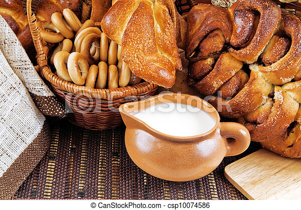 milk in a mug buns and appetizing rolls - csp10074586