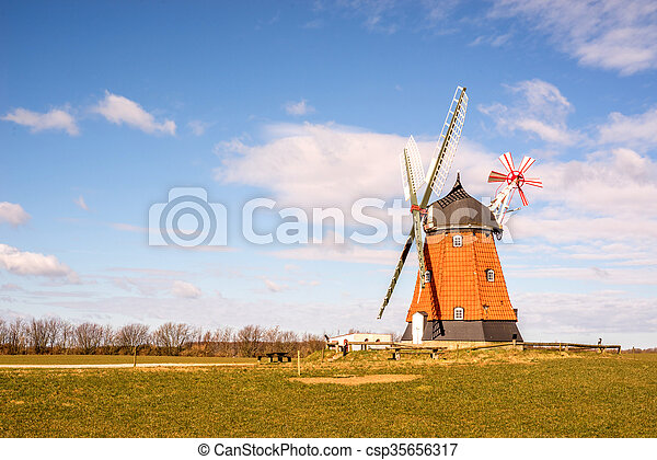 Mill on a green meadow in the spring - csp35656317