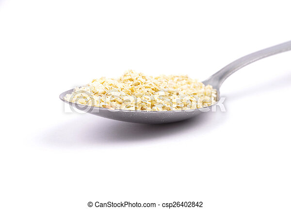 Millet flakes on spoon - csp26402842