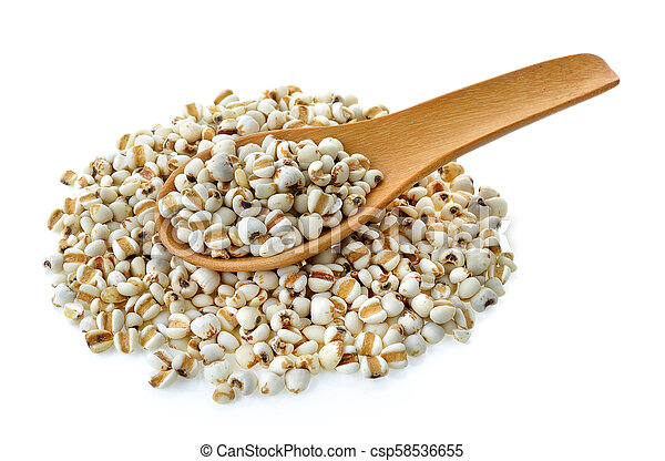 Millet in wood spoon on white background - csp58536655