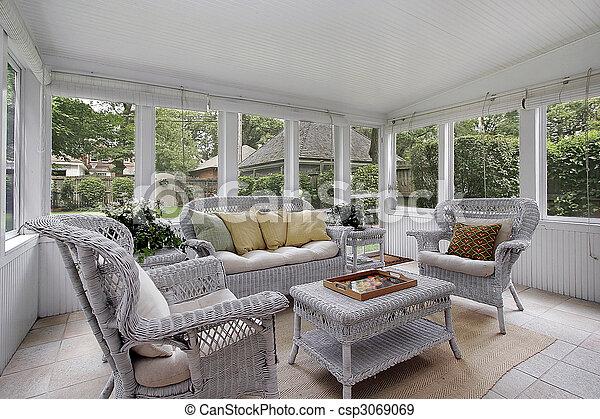Porche con muebles de mimbre - csp3069069