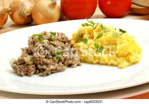 Minced meat with turmeric rice on a white plate - csp6033531