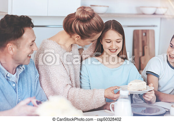 Mindful mother entertaining family with sweetest cake