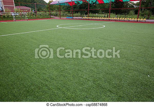 Mini Football Goal On An Artificial Grass . Inside of indoor football field - csp58874868