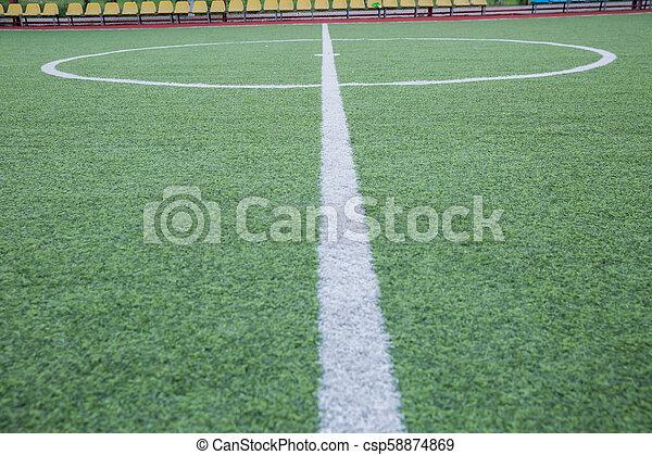 Mini Football Goal On An Artificial Grass . Inside of indoor football field . Mini football stadium center .soccer field center and ball top view background - csp58874869