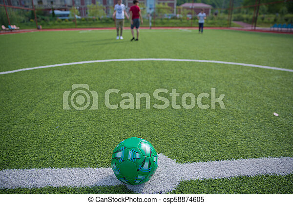 Mini Football Goal On An Artificial Grass . Inside of indoor football field . Mini soccer ball - csp58874605