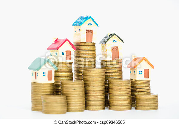 Mini house on stack of coins, isolated on white background, Concept of Investment property. - csp69346565