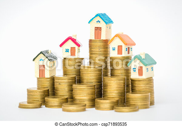Mini house on stack of coins, isolated on white background, Concept of Investment property. - csp71893535