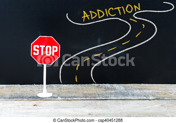 Mini STOP sign on the road to ADDICTION - csp40451288