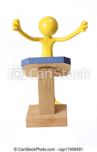 Miniature Figure on Rostrum - csp11006491