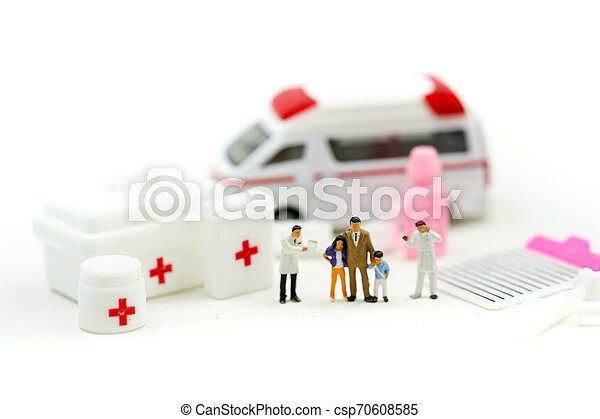 Miniature people : Doctor and Paramedic attending to patient in ambulance, Medicine ambulance concept - csp70608585