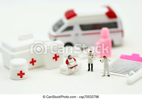 Miniature people : Doctor and Paramedic attending to patient in ambulance, Medicine ambulance concept - csp70533796