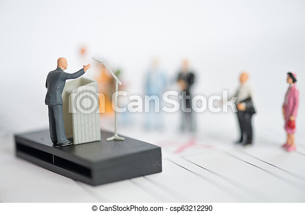 Miniature people : politician or party candidate in excited speech persuades - csp63212290