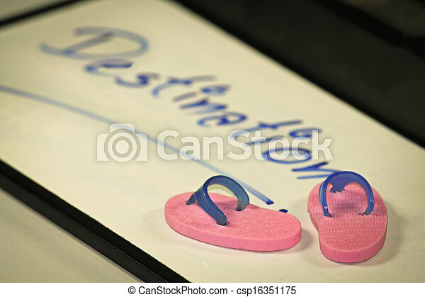Miniature rubber slippers with wording Destination, Concept - csp16351175