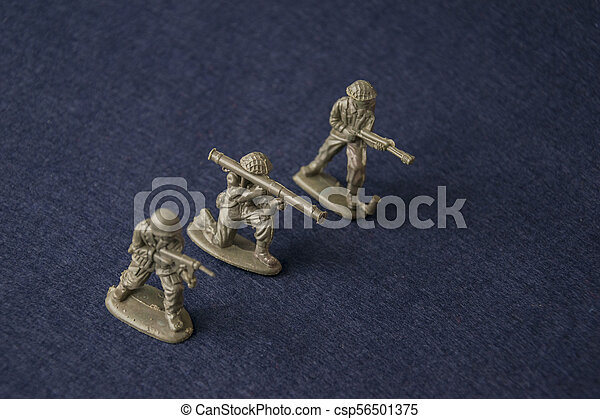 Miniature toy soldiers. Plastic toy military men at war. - csp56501375