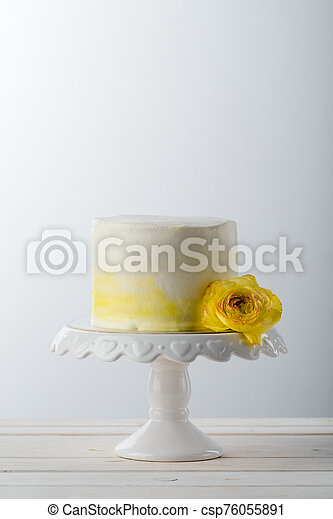 Minimalist Cake On A Stand Decorated With A Fresh Yellow Flower Close Up Neutral Background A Light Wooden Table Elegant Canstock