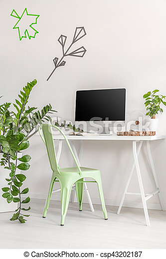 minimalist office interior with mint chair and plants shot of a