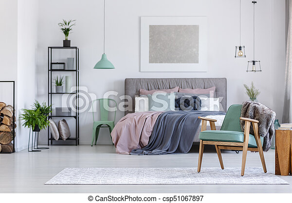 Mint Chair Next To Bed Stock Photo