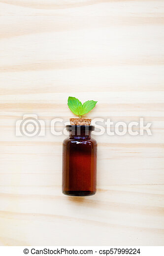 Mint Essential Oil in a Glass Bottle - csp57999224