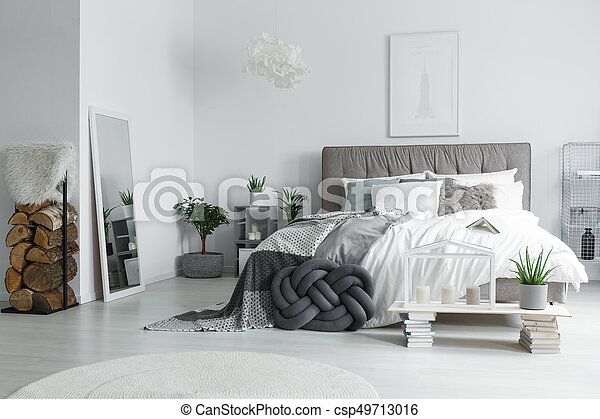 Mirror in bright bedroom - csp49713016