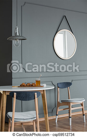 Mirror In Simple Dining Room Wooden Chairs Against Grey Molding Wall With Round Mirror In Simple Dining Room Interior Canstock