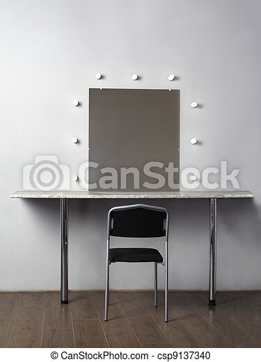mirror with lamps for makeup, black chair in studio, white wall - csp9137340