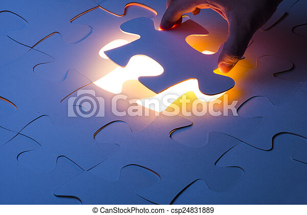 Missing jigsaw puzzle piece with light glow - csp24831889