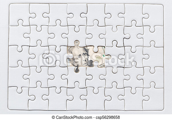 Missing jigsaw puzzle pieces on USA dollar background - csp56298658
