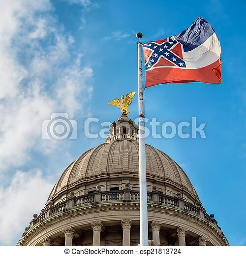 Mississippi state flag flying in front of capitol building in Ja - csp21813724