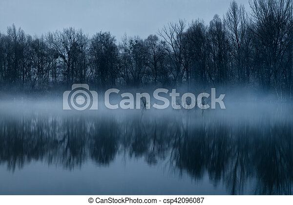 Misty dawn at the lake - csp42096087