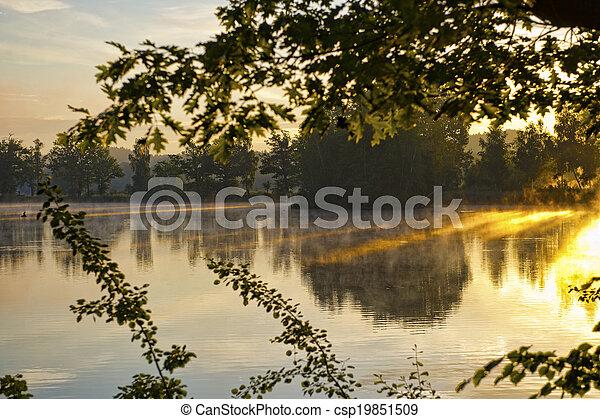 Misty dawn at the lake - csp19851509