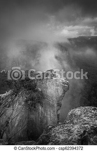 Misty fog at Hanging Rock Blue Mountains - csp62394372