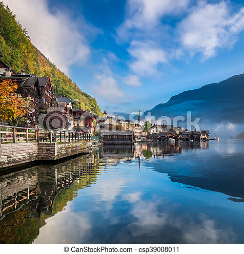 Misty lake at dawn in the Alps - csp39008011