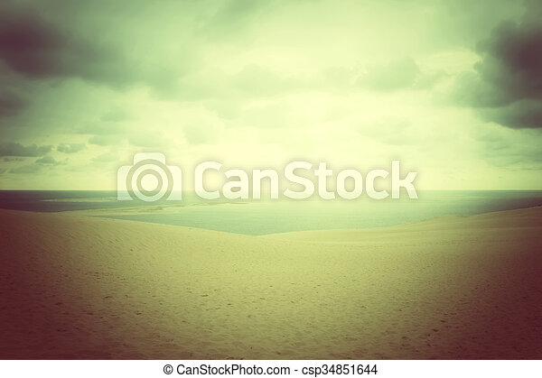 Misty landscape with sand dunes and sea - csp34851644