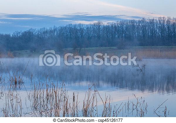 Misty morning at the lake - csp45126177