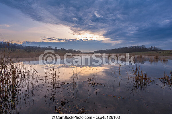 Misty morning at the lake - csp45126163
